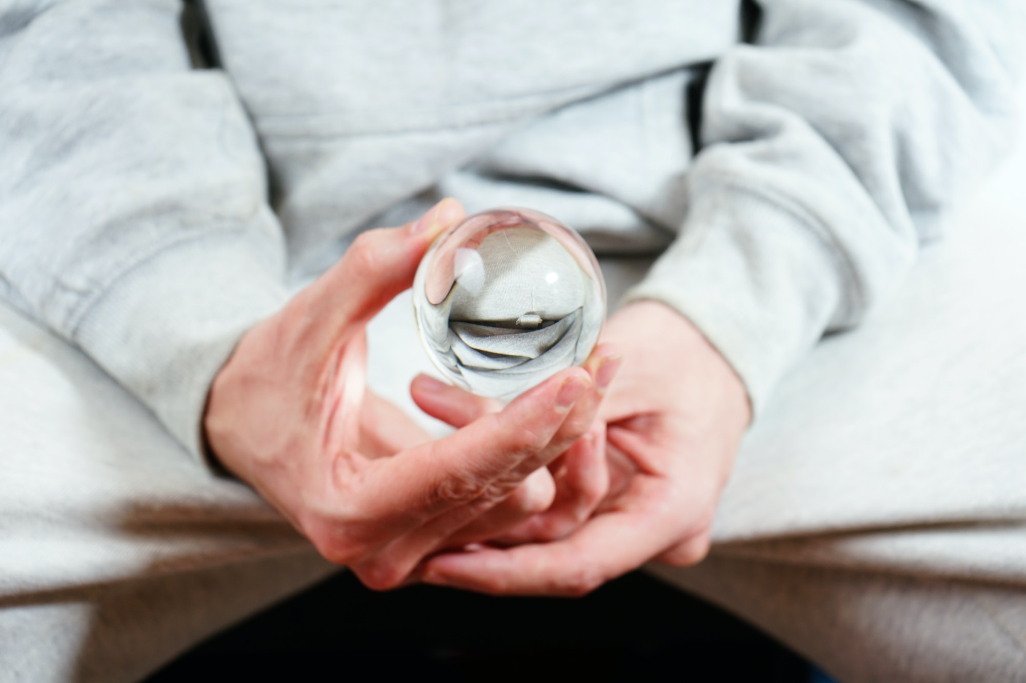 Man hands holding a crystal ball